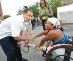 Governor David Paterson shaking hands w Anjali Forber-Pratt at Boilermaker 15k